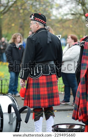 BEDFORD, ENGLAND  NOVEMBER 2014: Remembrance Day Parade - Member of Scottish Military Marching Band, shown on 9 November 2014 in Bedford - stock photo