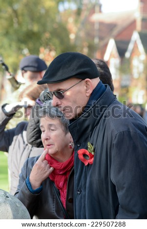 BEDFORD, ENGLAND  NOVEMBER 2014: Remembrance Day Parade - people paying their respects, shown on 9 November 2014 in Bedford - stock photo