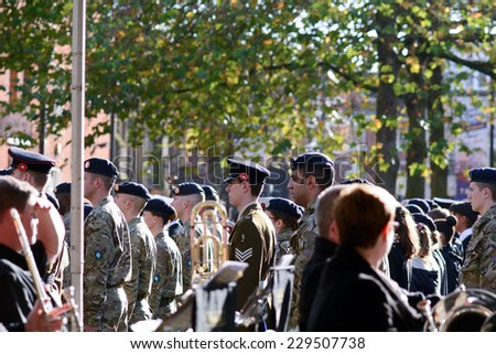 BEDFORD, ENGLAND  NOVEMBER 2014: Remembrance Day Parade - Salvation Army band and soldiers standing to attention, shown on 9 November 2014 in Bedford - stock photo