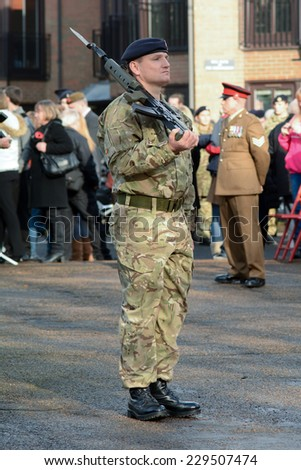 BEDFORD, ENGLAND  NOVEMBER 2014: Remembrance Day Parade - Solider and offider standing to attention, shown on 9 November 2014 in Bedford - stock photo