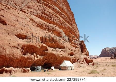 Bedouin camp near rock in Wadi Rum desert, Jordan - stock photo