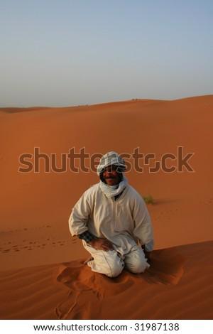 Bedouin in desert Sahara - stock photo