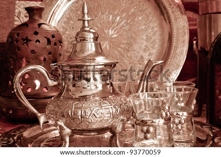 Bedouin tea party set up in a warm oriental candelight  atmosphere - stock photo