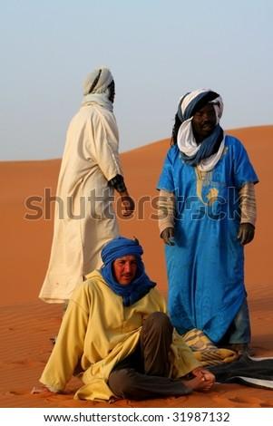 Bedouins in desert Sahara - stock photo