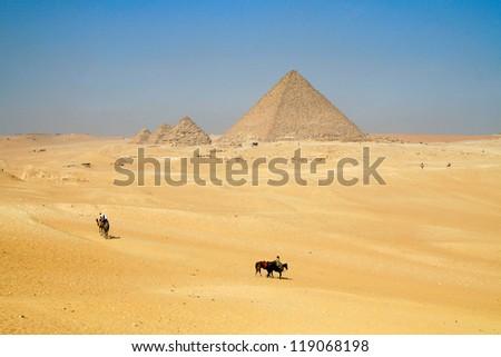 Bedouins in the desert near pyramids, Egypt - stock photo