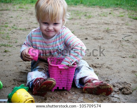 bedraggled baby play with  sand