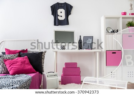 Bedroom and study room combined. Black, pink and white interior for girl.