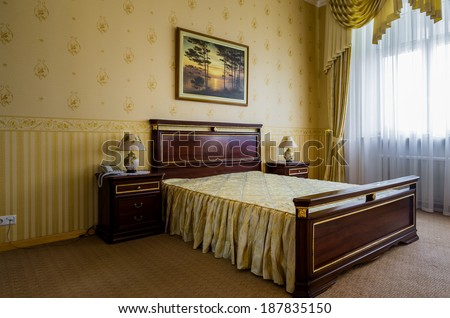 Bedroom classicism interior with paint on the wall - stock photo