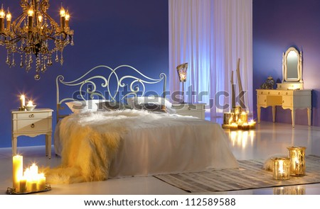 bedroom in candlelight - stock photo