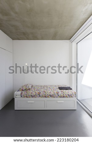 Bedroom in modern vacation house - stock photo