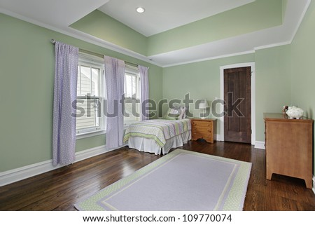 Bedroom in suburban home with green walls - stock photo