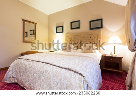 Bedroom interior in the evening - stock photo