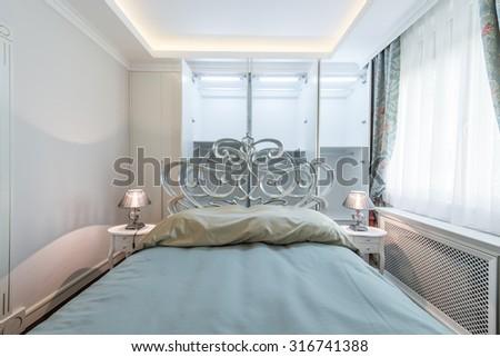 Bedroom interior with empty white wardrobe - stock photo