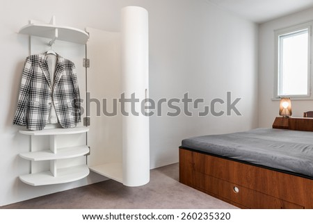 Bedroom interior with open closet