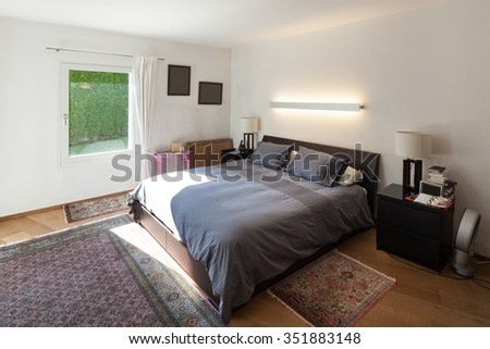 bedroom of a furnished interior, double bed - stock photo