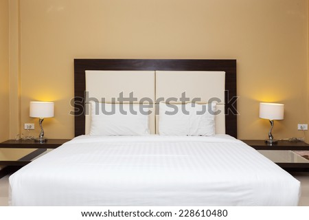 bedroom with bed and lamp decoration - stock photo