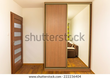 Bedroom with built in modern wardrobe - stock photo