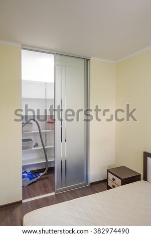 Bedroom with built in modern wardrobe - Empty shelves - stock photo