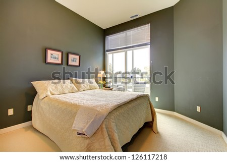 Bedroom with grey green walls and white bedding.