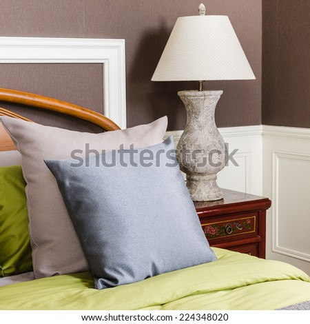bedroom with grey lamp on nightstand - stock photo
