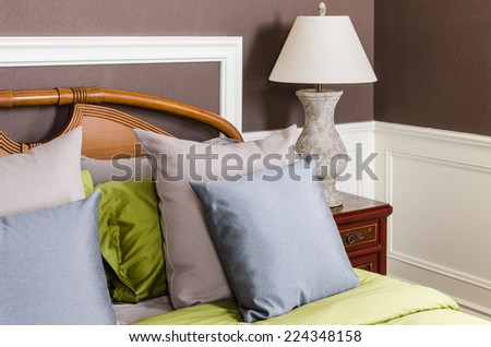 bedroom with grey lamp on wooden nightstand - stock photo