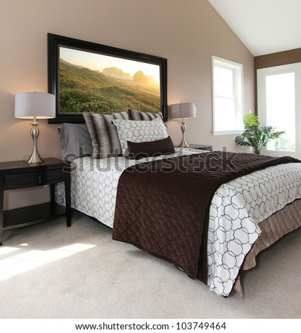 Bedroom with modern white and brown bed and nightstands - stock photo