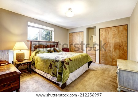 Bedroom with wooden furniture set and two closets