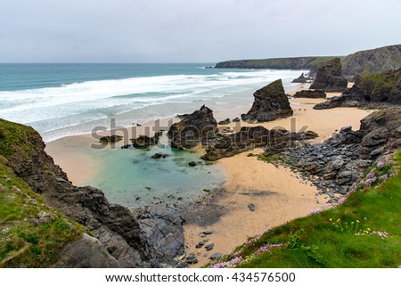 Bedruthan Steps, North Cornwall. The major sea stacks visible, are Redcove Island, Samaritan Island, and Queen Bess Rock (small to seaward).  The rocks in the foreground (centre photo) are un-named. - stock photo