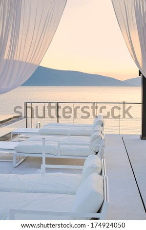 Beds by the sea in the big canopy  - stock photo