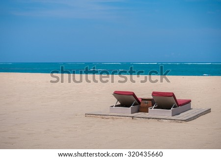 beds on a tropical beach - stock photo