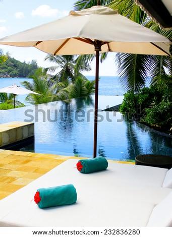 Beds Umbrellas Exotic  - stock photo
