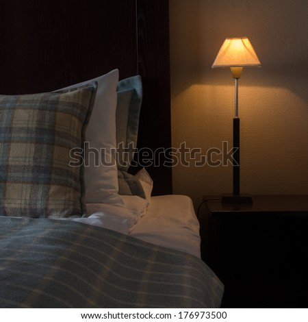 Bedside at a hotel by night - stock photo
