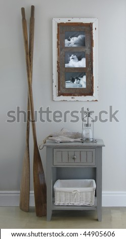 Bedside table with oars and photo of cat