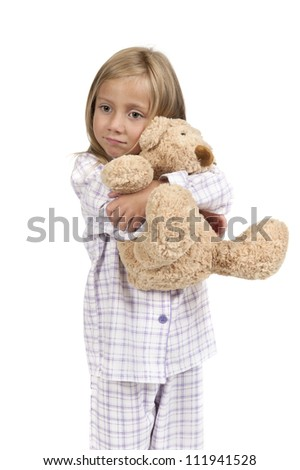 Bedtime - child in pajamas with teddy bear - stock photo