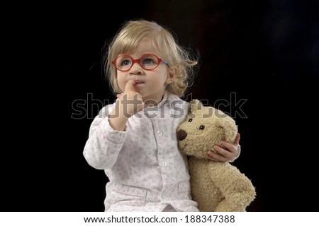 bedtime for little toddler, black background - stock photo