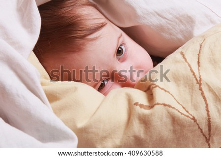 bedtime  (young girl lying on the bed under the covers)