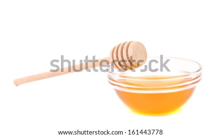Bee honey with wooden dipper. Isolated on a white background - stock photo