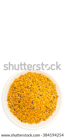 Bee pollen in white bowl over white background