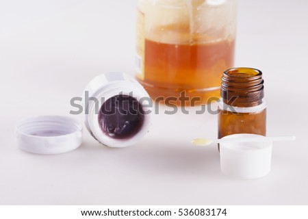 Bee products over white, with royal jelly, honey and bee venom, horizontal image