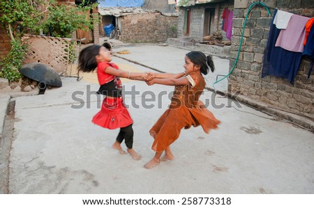 BEED, MAHARASHTRA, INDIA - March 23, 2012: unidentified girls playing in rural village Salunkwadi - stock photo