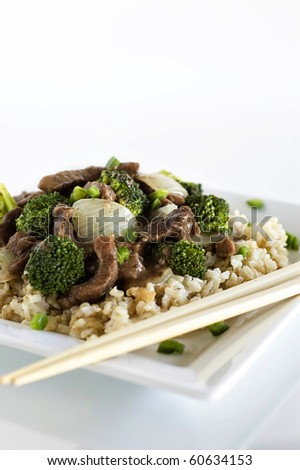 Beef and Broccoli and Brown Rice with Chopsticks - stock photo
