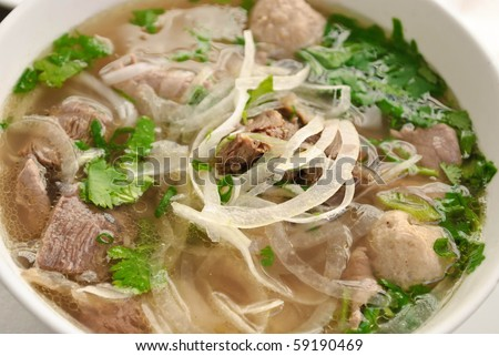 Beef and onion soup with green coriander leaves