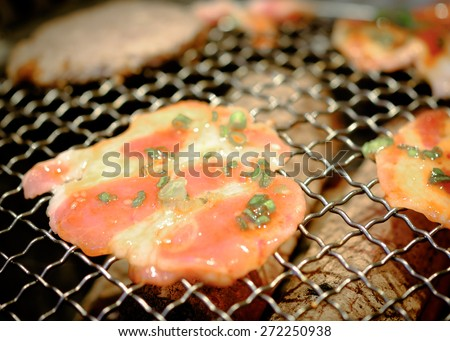 Beef and Pork grill on hot coals. This kind of food is a Korean BBQ style. - stock photo