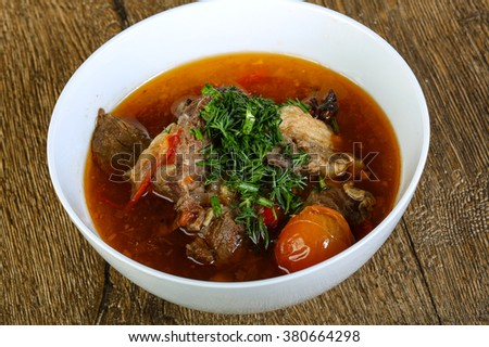 Beef and vegetables soup with tomato and dill