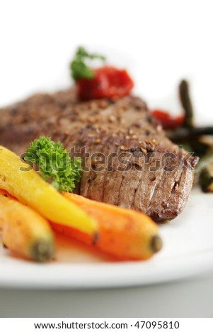 Beef Angus steak served with fresh vegetables