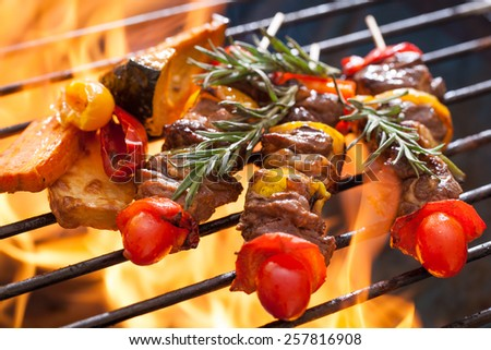 Beef bbq on grill with fire - stock photo