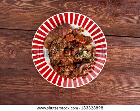 Beef bourguigno - dish originates from Burgundy region (in French, Bourgogne) ?stew prepared with beef braised in red wine.farm-style - stock photo