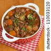 Beef bourguignon in casserole dish - stock photo