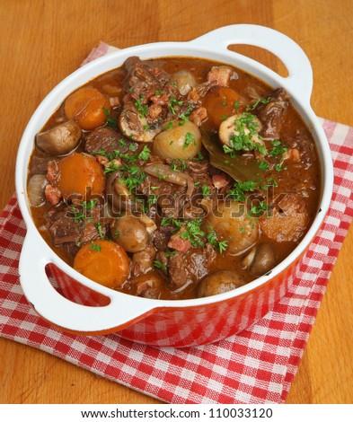 Beef bourguignon in casserole dish - stock photo