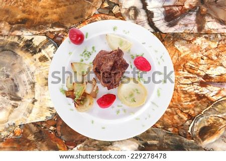 beef bourguignon in wine with artichoke and marinated vegetables on white plate isolated over white background high resolution - stock photo